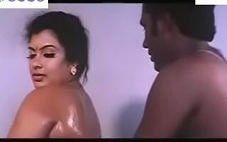 a brahmin couple having oil bath